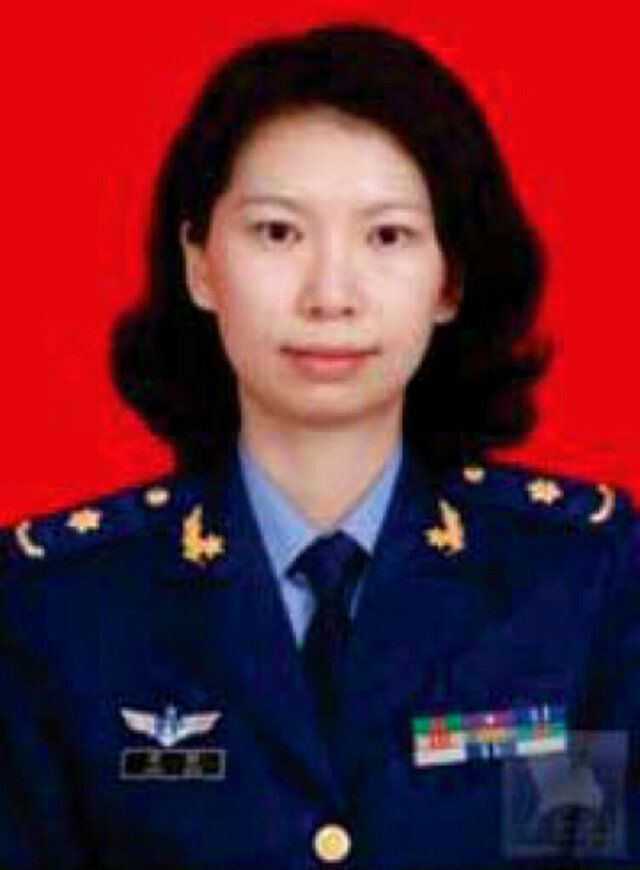 ADDS NO SALES RESTRICTION- FILE - This undated file photo provided by the U.S. Justice Department shows Juan Tang in her China People's Liberation Army military uniform. Tang a Chinese scientist charged with visa fraud after U.S. authorities said she concealed her military ties to China was arrested after she left the Chinese consulate in San Francisco to seek medical care for her asthma, court documents showed. A hearing on whether Tang, should be released on bail is scheduled for Friday, July 31, 2020. She is being held at a Sacramento County jail on behalf of federal authorities after her arrest last week. Tang and three other scientists living in the U.S., face charges of lying about their status as members of China's People's Liberation Army. All were charged with visa fraud, the Justice Department said. (Justice Department via AP,File)