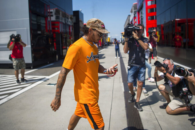 British Formula One driver Lewis Hamilton of Mercedes AMG GP walks through the Hungaroring circuit in Mogyorod, Hungary, Thursday, Aug. 1, 2019. The Hungarian Formula One Grand Prix will take place on Aug. 4, 2019. (Zoltan Balogh/MTI via AP)
