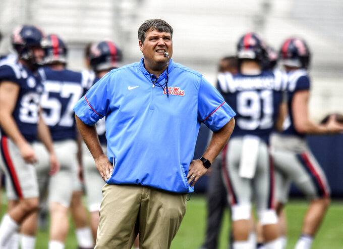 Mississippi's coach Matt Luke watches the team warm up before the Grove Bowl spring NCAA college football game at Vaught-Hemingway Stadium in Oxford, Miss. on Saturday, April 6, 2019. (Bruce Newman/The Oxford Eagle via AP)