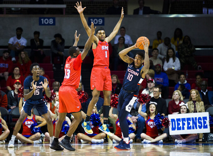 SMU forward Feron Hunt (1) and guard CJ White (13) defend against Connecticut guard Brendan Adams (10) during the first half of an NCAA college basketball game Wednesday, Feb. 12, 2020, in Dallas. (Ashley Landis/The Dallas Morning News via AP)