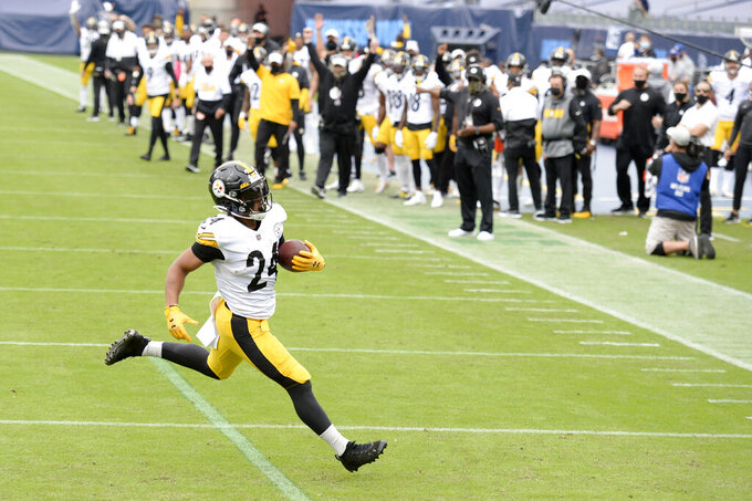 Pittsburgh Steelers running back Benny Snell (24) scores a touchdown against the Tennessee Titans in the first half of an NFL football game Sunday, Oct. 25, 2020, in Nashville, Tenn. (AP Photo/Mark Zaleski)