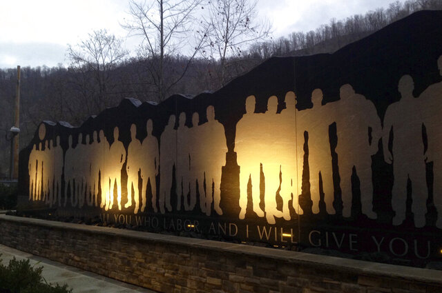 FILE - In this Dec. 3, 2015 file photo, The Upper Big Branch Miners Memorial is shown  in Whitesville, W.Va. A public service scheduled for Sunday, April 5, 2020, at a memorial in Whitesville, W.Va., on the 10-year anniversary of the disaster was canceled due to concerns over the coronavirus pandemic.  (AP Photo/John Raby, File)