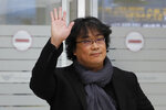 South Korean director Bong Joon-ho waves upon his arrival at the Incheon International Airport in Incheon, South Korea, Sunday, Feb. 16, 2020. South Koreans are reveling in writer-director Bong's dark comic thriller,