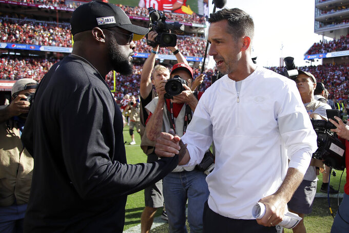 Pittsburgh Steelers head coach Mike Tomlin, left, greets San Francisco 49ers head coach Kyle Shanahan after an NFL football game between the 49ers and the Steelers in Santa Clara, Calif., Sunday, Sept. 22, 2019. (AP Photo/Ben Margot)