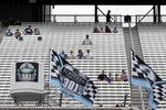 Fans sit socially distanced due to the coronavirus pandemic in the grandstand before a NASCAR Cup Series auto race, Sunday, Aug. 2, 2020, at the New Hampshire Motor Speedway in Loudon, N.H. (AP Photo/Charles Krupa)