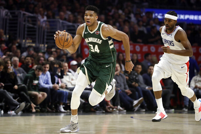 Milwaukee Bucks' Giannis Antetokounmpo (34) dribbles past Los Angeles Clippers' Maurice Harkless during the second half of an NBA basketball game Wednesday, Nov. 6, 2019, in Los Angeles. (AP Photo/Marcio Jose Sanchez)