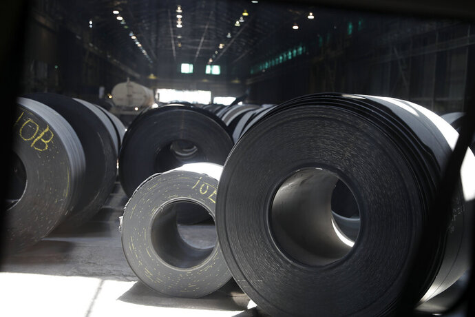 FILE - In this June 28, 2018, file photo, rolls of finished steel are seen at the U.S. Steel Granite City Works facility in Granite City, Ill.  Companies seeking relief from President Donald Trump's taxes on imported steel and aluminum ran into long delays and cumbersome paperwork, a federal watchdog found, Wednesday, Sept. 16, 2020. The U.S. Government Accountability Office reported that the Commerce Department, overwhelmed by companies lobbying to avoid the tariffs, could not meet its own deadline for processing around three-fourths of the requests. (AP Photo/Jeff Roberson, File)