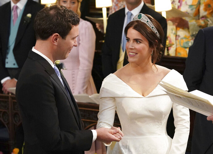 Princess Eugenie of York and Jack Brooksbank during their wedding ceremony at St George's Chapel, Windsor Castle, near London, England, Friday Oct. 12, 2018.  (Jonathan Brady, Pool via AP)