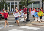 Demonstrators cross Court street in Auburn as the group grew larger to line both sides of the street while maintaining social distancing on Wednesday, Aug. 12, 2020. The group was calling for a greater emphasis on safety in the return to school protocols. (Andree Kehn/Sun Journal via AP)