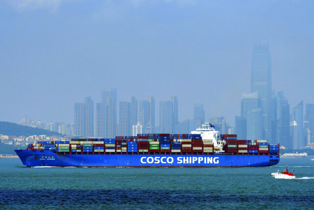 A China COSCO Shipping container ship sails past the skyline of Qingdao in eastern China's Shandong Province, on July 28, 2020. China's exports rose 7.2% in July over a year earlier despite the coronavirus pandemic. Sales to the United States rose 12.5% despite lackluster U.S. economic activity and lingering tariff war with Washington. (Chinatopix via AP)