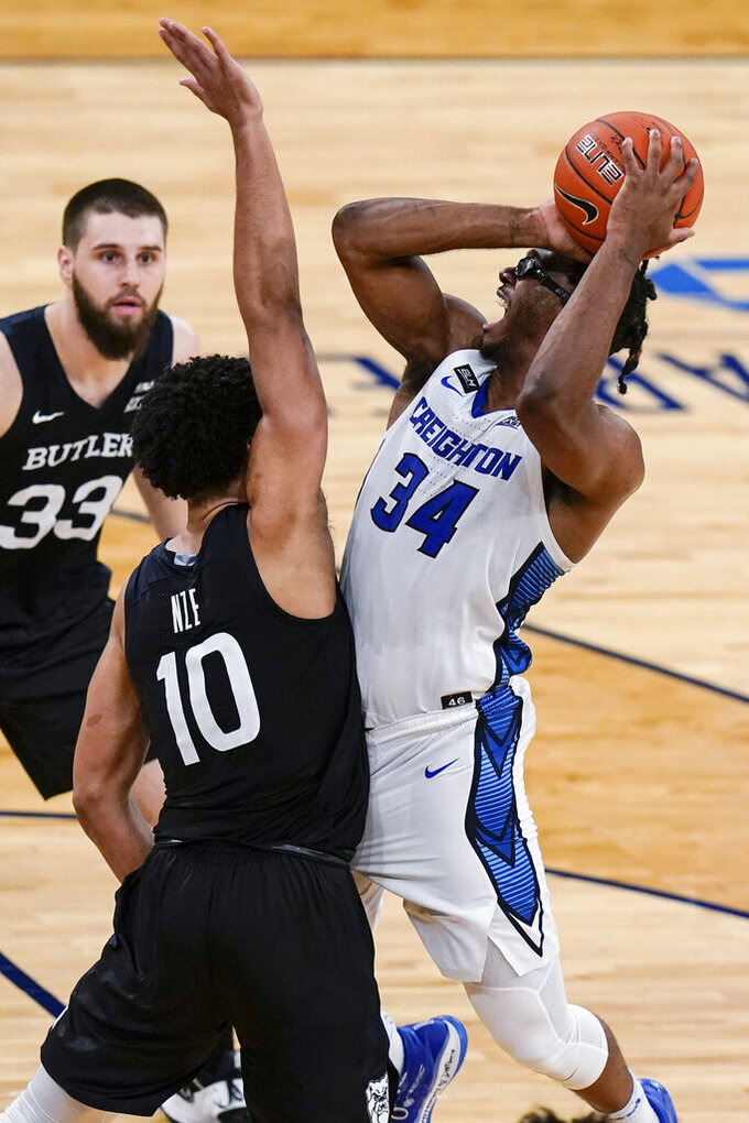 Creighton's Denzel Mahoney (34) draws a foul on Butler's Bryce Nze (10) during the second half of an NCAA college basketball game in the Big East men's tournament Thursday, March 11, 2021, in New York. (AP Photo/Frank Franklin II)