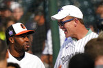 Former NFL quarterback Peyton Manning, right, speaks with American League's Cedric Mullins, of the Baltimore Orioles, during batting practice for the MLB All-Star baseball game, Monday, July 12, 2021, in Denver. (AP Photo/Gabriel Christus)