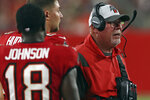 Tampa Bay Buccaneers head coach Bruce Arians watches his team play the Tennessee Titans during the second half of an NFL preseason football game Saturday, Aug. 21, 2021, in Tampa, Fla. (AP Photo/Mark LoMoglio)