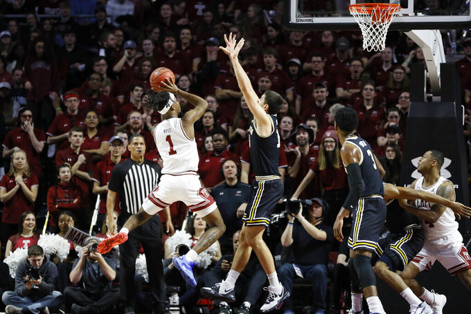 Temple's Quinton Rose, left, goes up to shoot against Villanova's Cole Swider during the first half of an NCAA college basketball game, Sunday, Feb. 16, 2020, in Philadelphia. (AP Photo/Matt Slocum)