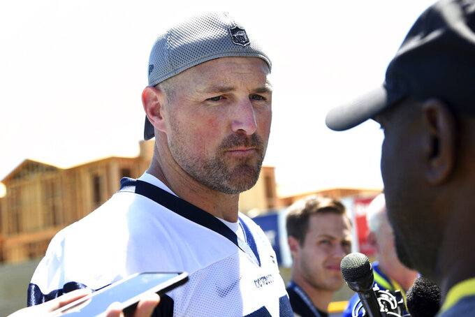 Dallas Cowboys tight end Jason Witten talks to the media following practice at the NFL football team's training camp in Oxnard, Calif., Saturday, July 27, 2019. (AP Photo/Michael Owen Baker)