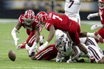 Louisiana-Lafayette linebackers Chauncey Manac (17) and Ferrod Gardner (7) dive for the football fumbled by Mississippi State quarterback Tommy Stevens (7) in the first quarter of an NCAA college football game in New Orleans, Saturday, Aug. 31, 2019. It was recovered by Manac. (AP Photo/Chuck Cook)