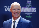 """FILE - Mark Messier poses on the red carpet before the NHL Awards in Las Vegas on  June 20, 2018.  Messier's memoir """"No One Wins Alone"""" will be published in October, by Gallery Books, a Simon & Schuster imprint. (AP Photo/John Locher, File)"""