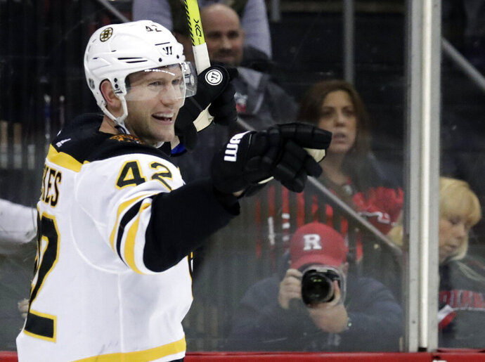 FILE - In this March 21, 2019, file photo, Boston Bruins' David Backes celebrates after scoring against the New Jersey Devils during the third period of an NHL hockey game in Newark, N.J. Backes will face his former team when the Bruins host the St. Louis Blues Monday, May 27, in Game 1 of the Stanley Cup Final. (AP Photo/Julio Cortez)