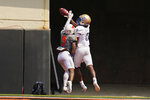 Oklahoma State cornerback Christian Holmes, left, breaks up a pass intended for Tulsa wide receiver Ezra Naylor II, right, on an attempted two-point conversion in the second half of an NCAA college football game, Saturday, Sept. 11, 2021, in Stillwater, Okla. (AP Photo/Sue Ogrocki)