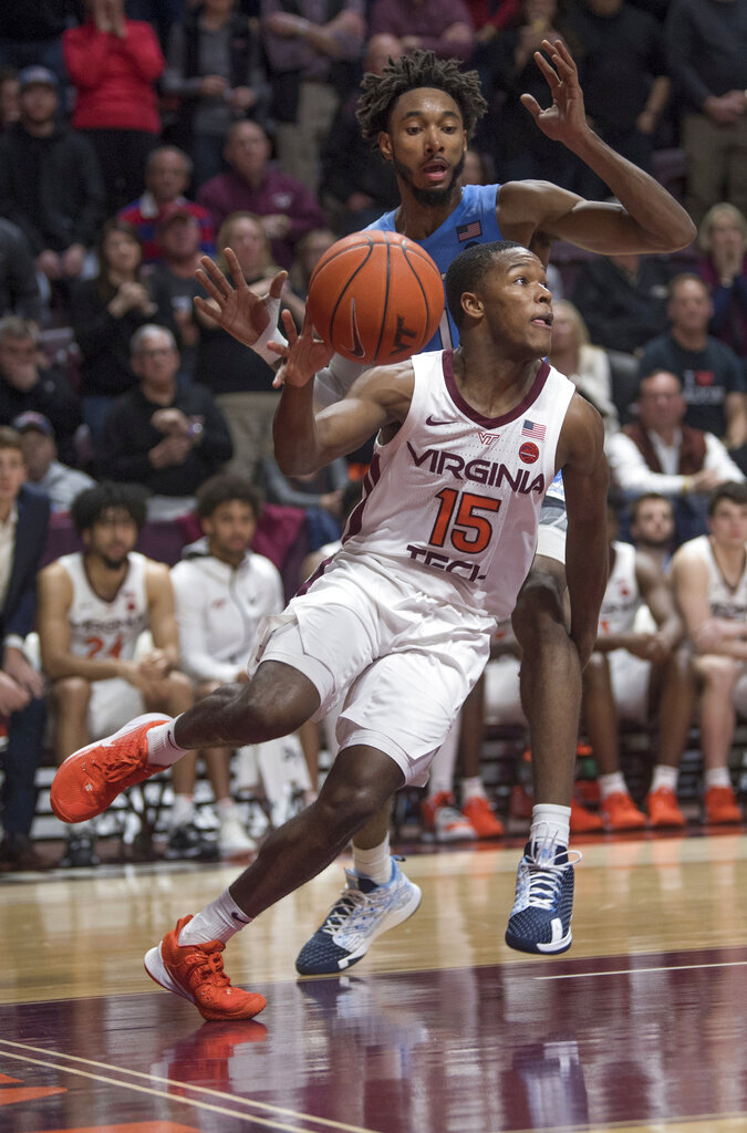 Virginia Tech guard Jalen Cone maintains his dribble in front of North Carolina defender Rechon Black (1) during the second half of an NCAA college basketball game in Blacksburg, Va., Wednesday, Jan. 22, 2020.(AP Photo/Lee Luther Jr.)