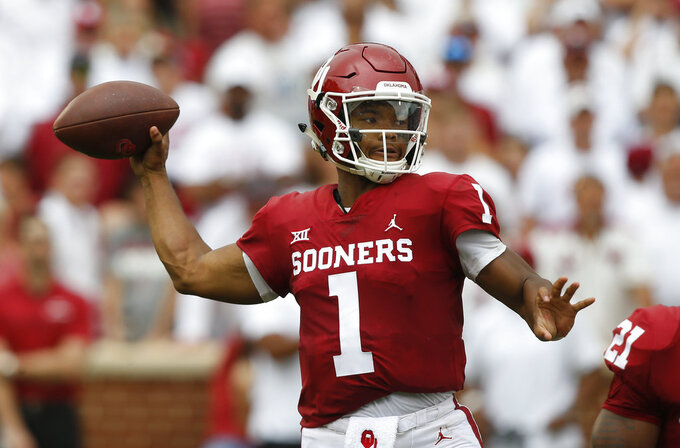 FILE - In this Sept. 8, 2018, file photo, Oklahoma quarterback Kyler Murray (1) throws during an NCAA college football game between UCLA and Oklahoma in Norman, Okla. Oklahoma's Kyler Murray, West Virginia's Will Grier, Iowa State's Brock Purdy and Sam Ehlinger of Texas have been impressive and could determine which teams makes it to the Dec. 1 title game in Arlington, Texas. (AP Photo/Sue Ogrocki, File)