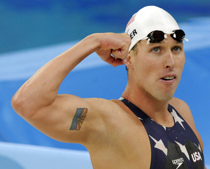 FILE - This Aug. 12, 2008, file photo shows United States' relay swimmer Klete Keller at the Beijing 2008 Olympics. The five-time Olympic medalist pleaded guilty on Wednesday, Sept. 29, 2021, to a felony charge for storming the U.S. Capitol during the Jan. 6 riot. Keller faces 21 to 27 months in prison for his guilty plea to obstruction of an official proceeding. (AP Photo/Thomas Kienzle, File)