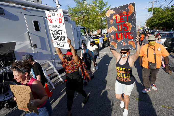 Protesters march along the streets to protest the shooting of Andrew Brown Jr. in Elizabeth City, N.C., Wednesday, April 28, 2021. A judge has denied requests to release body camera video in the case of Brown, a Black man who was killed by North Carolina deputies. (AP Photo/Steve Helber)