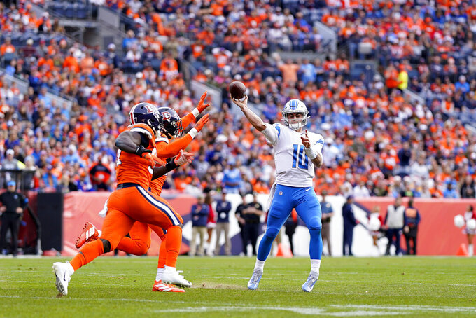 Detroit Lions quarterback David Blough (10) throws under pressure by the Denver Broncos during the first half of an NFL football game, Sunday, Dec. 22, 2019, in Denver. (AP Photo/Jack Dempsey)