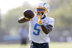 Los Angeles Chargers wide receiver Josh Palmer catches a pass during practice at the NFL football team's training camp in Costa Mesa, Calif., Saturday, July 31, 2021. (AP Photo/Alex Gallardo)