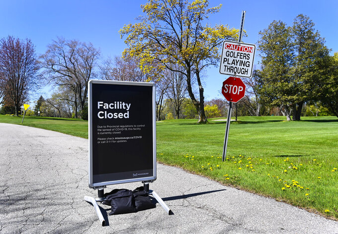 A closed Lakeview Golf Course facility is shown during the COVID-19 pandemic in Mississauga, Ontario, on Wednesday, May 12, 2021. The Ontario government has deemed golf courses and other outdoor recreational sports unsafe to open at this current time. (Nathan Denette/The Canadian Press via AP)