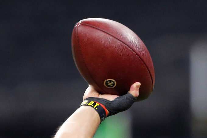 New Orleans Saints quarterback Drew Brees' thumb is seen as he warms up before an NFL football game against the Arizona Cardinals in New Orleans, Sunday, Oct. 27, 2019. (AP Photo/Bill Feig)