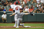 Baltimore Orioles' Ryan Mountcastle (6) is safe at first on a single as Tampa Bay Rays first baseman Jordan Luplow reaches for the throw in the fifth inning of baseball game, Sunday, Aug. 29, 2021, in Baltimore. (AP Photo/Gail Burton)