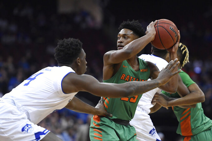 Florida A&M forward Bryce Moragne (23) looks to pass as Seton Hall forward Tyrese Samuel (4) defends during the first half of an NCAA college basketball game, Saturday, Nov. 23, 2019 in Newark, N.J. (AP Photo/Sarah Stier)