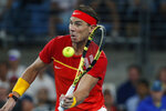 CAPTION CORRECTS SPELLING TO SURNAME Rafael Nadal of Spain plays a shot against Novak Djokovic of Serbia during their ATP Cup tennis match in Sydney, Sunday, Jan. 12, 2020. (AP Photo/Steve Christo)