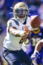 Navy quarterback Dalen Morris (8) pitches the ball during an NCAA football game against East Carolina, Saturday, Oct. 17, 2020, in Greenville, N.C. (AP Photo/Jacob Kupferman)