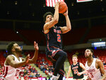 Utah guard Sedrick Barefield (2) drives to the basket for a layup as Washington State guard Ahmed Ali (23) and forward Marvin Cannon (5) watch during the first half of an NCAA college basketball game Saturday, Feb. 23, 2019, in Pullman, Wash. (Pete Caster/Lewiston Tribune via AP)