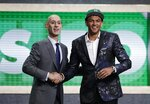 NBA Commissioner Adam Silver poses for photographs with Washington's Matisse Thybulle after the Boston Celtics selected him as the 20th pick overall in the NBA basketball draft Thursday, June 20, 2019, in New York. (AP Photo/Julio Cortez)