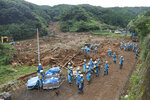Rescuers search missing people at the site of a mudslide caused by heavy rain in Natsugi town, Kumamoto prefecture, southwestern Japan, Sunday, July 5, 2020. Heavy rain in the Kumamoto region triggered flooding and mudslides Saturday and left dozens still being stranded at their homes and other facilities. (Kyodo News via AP)