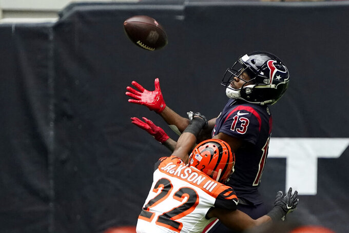 Houston Texans wide receiver Brandin Cooks (13) catches a pass for a first down as Cincinnati Bengals cornerback William Jackson III (22) defends during the first half of an NFL football game Sunday, Dec. 27, 2020, in Houston. (AP Photo/Sam Craft)