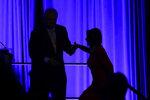 Former U.S. Rep. Robert Brady helps House Speaker Nancy Pelosi of Calif., to the stage during a Pennsylvania Democratic Party fundraiser in Philadelphia, Friday, Nov. 1, 2019. (AP Photo/Matt Rourke)