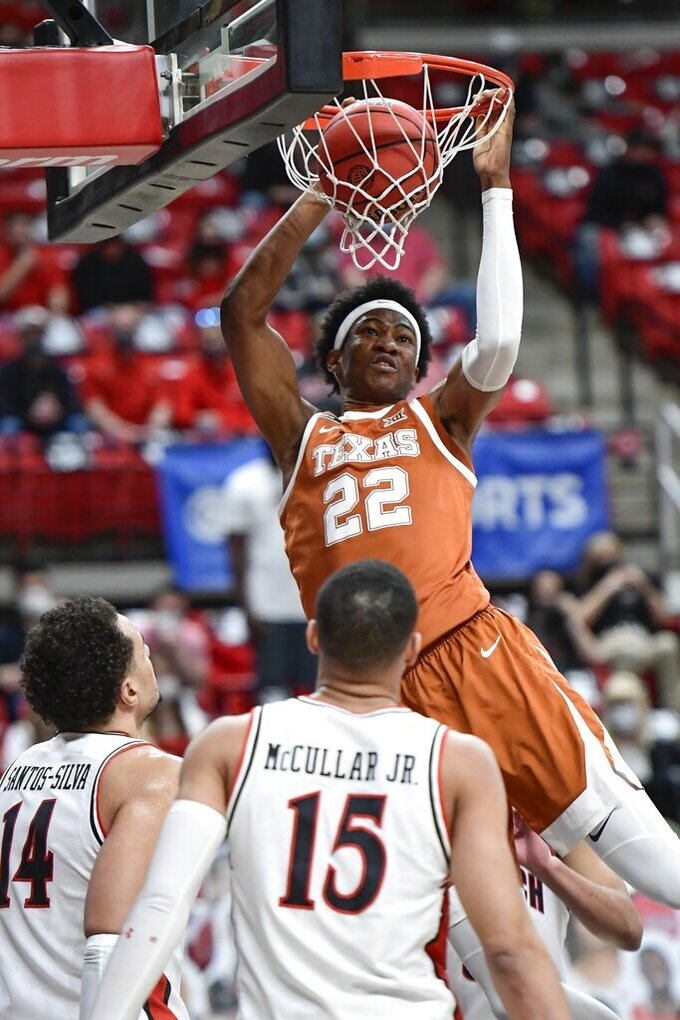 Texas' Kai Jones (22) dunks the ball during the first half of an NCAA college basketball game against Texas Tech in Lubbock, Texas, Saturday, Feb. 27, 2021. (AP Photo/Justin Rex)