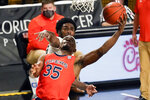 Auburn guard Devan Cambridge (35) goes in for a shot in front of Central Florida guard Dre Fuller Jr. during the second half of an NCAA college basketball game, Monday, Nov. 30, 2020, in Orlando, Fla. (AP Photo/John Raoux)