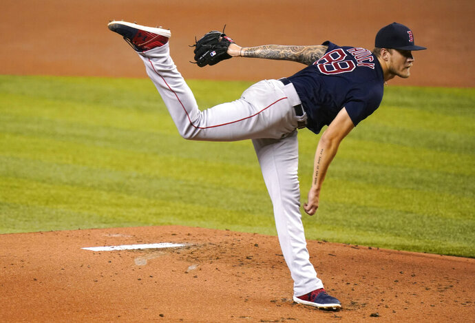 Boston Red Sox starting pitcher Tanner Houck follows through on a delivery during the first inning of a baseball game against the Miami Marlins, Tuesday, Sept. 15, 2020, in Miami. (AP Photo/Lynne Sladky)