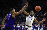 Kansas State guard Kamau Stokes (3) gets the ball to a teammate while covered by TCU guard Desmond Bane (1) during the second half of an NCAA college basketball game in Manhattan, Kan., Saturday, Jan. 19, 2019. (AP Photo/Orlin Wagner)