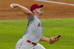 Los Angeles Angels starting pitcher Dylan Bundy throws to the Texas Rangers in the first inning of a baseball game in Arlington, Texas, Thursday, Sept. 10, 2020. (AP Photo/Tony Gutierrez)