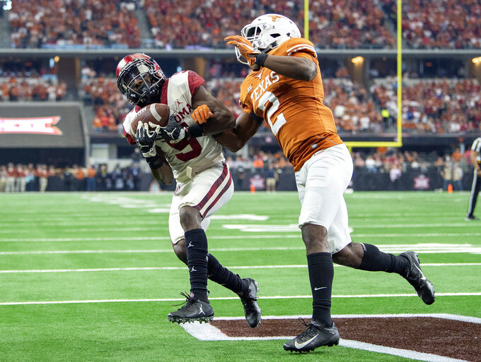 Texas defensive back Kris Boyd (2) breaks up a pass in the end zone intended for Oklahoma wide receiver Marquise Brown (5) during the first half of the Big 12 Conference championship NCAA college football game on Saturday, Dec. 1, 2018, in Arlington, Texas. (AP Photo/Jeffrey McWhorter)