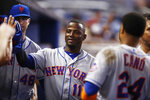 New York Mets' Adeiny Hechavarria (11) celebrates scoring during the sixth inning of a baseball game against the Miami Marlins on Sunday, July 14, 2019, in Miami. (AP Photo/Brynn Anderson)