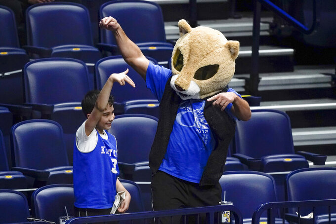 Kentucky fans cheer in the second half of an NCAA college basketball game against Mississippi State in the Southeastern Conference Tournament Thursday, March 11, 2021, in Nashville, Tenn. (AP Photo/Mark Humphrey)