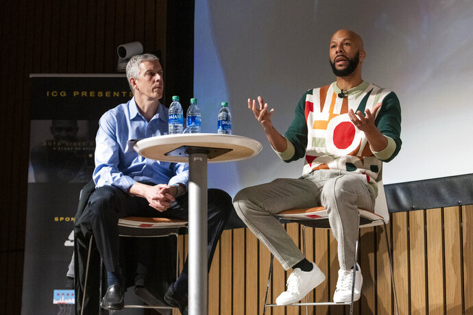 Arne Duncan, left, and Common help moderate a conversation and private screening of