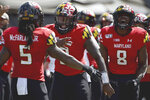 FILE - In this Sept. 7, 2019, file photo, Maryland Terrapins running back Anthony McFarland Jr. (5) celebrates with Tyrrell Pigrome (3) and Tayon Fleet-Davis (8) after scoring a touchdown against Syracuse during the first half of an NCAA college football game, in College Park, Md. Maryland's annual quarterback shuffle appears set to continue, as Josh Jackson's ankle injury sets the stage for Tyrrell Pigrome to get his first start of the season Saturday at Purdue. (AP Photo/Will Newton)